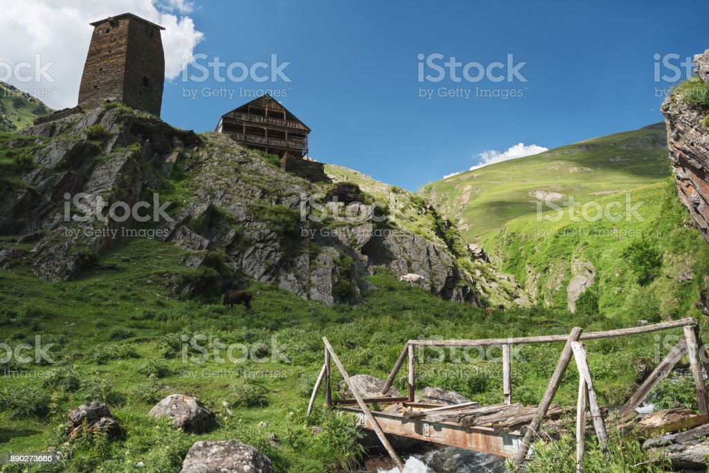 Ruins of Georgian defensive towers on a mountain hill. Landscape of Caucasus mountains with Tusheti towers at the forground in summer stock photo