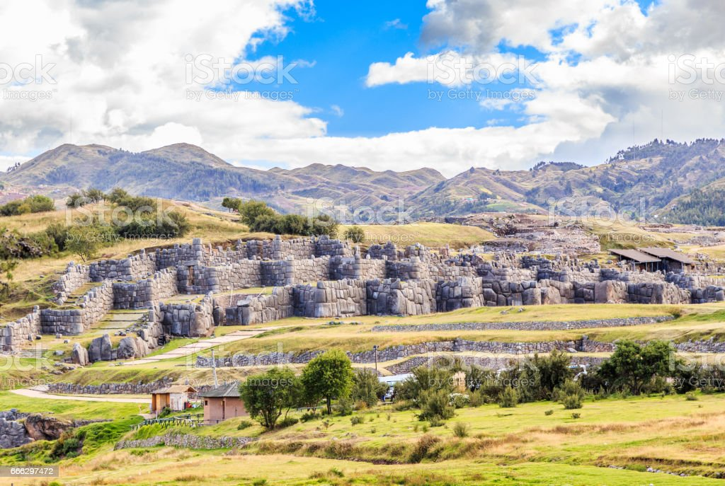 Ruins of Inkan fortress Saksaywaman with mountains in background, Cuzco, Peru stock photo