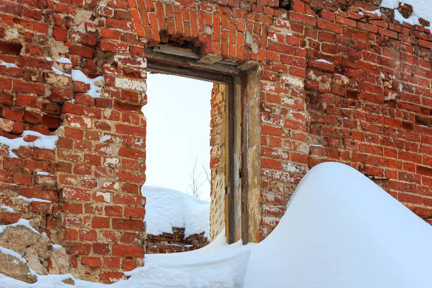 Ruins of old brick wall with window hole stock photo