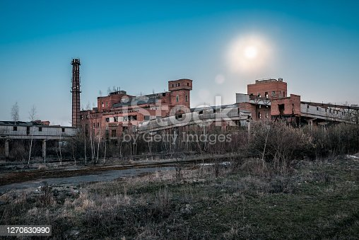 ruins of old abandoned factory under the moon