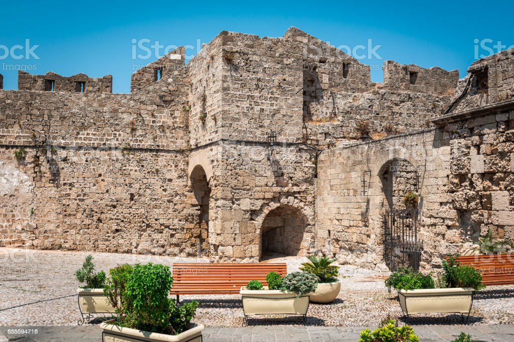 Ruins of old medieval fortress in Rhodes town on Rhodes island, Greece stock photo