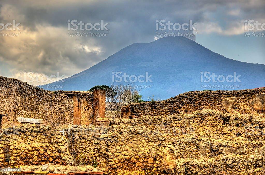 Ruins of Pompeii with Mount Vesuvius in the background stock photo