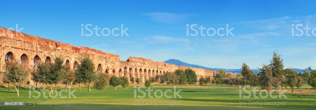Ruins of the ancient aqueduct on Appia Way in Rome, Italy stock photo