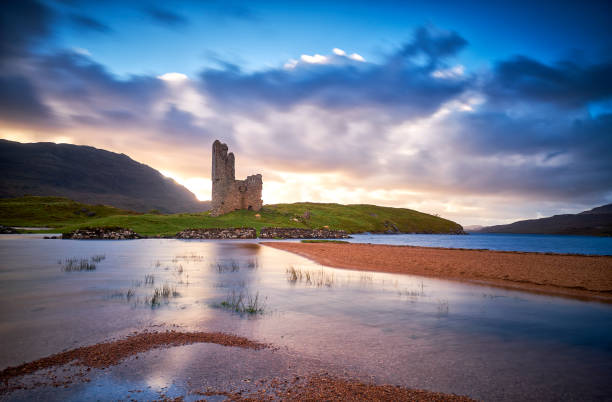 Ruins of the Ardvreck castle on the shores of Loch Assynt at sunset, Sutherland, Highlands of Scotland. stock photo