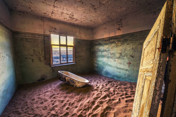 Ruins of the mining town Kolmanskop in the Namib desert near Luderitz in Namibia stock photo