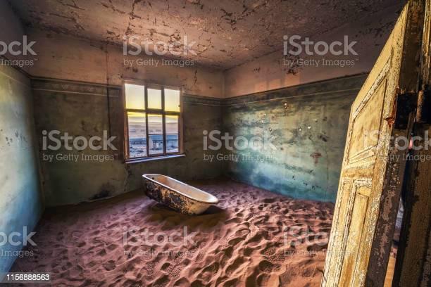Photo of Ruins of the mining town Kolmanskop in the Namib desert near Luderitz in Namibia