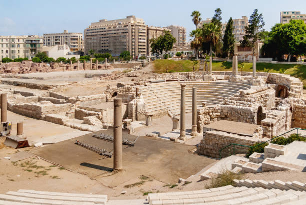Ruins of the Roman amphitheatre of the II—IV centuries. Architectural landmark in Alexandria, Egypt. stock photo
