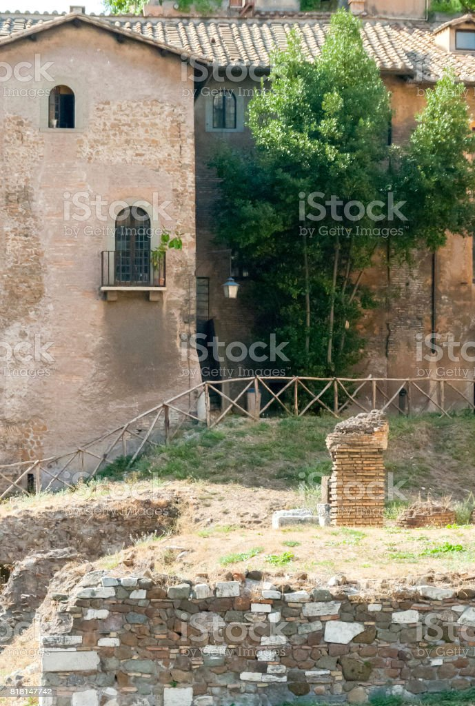 Ruins of the Temple of Apollo next to the 12 BCE era Theater of Marcellus and ancient companion building now repurposed as apartments, Rome, Italy stock photo