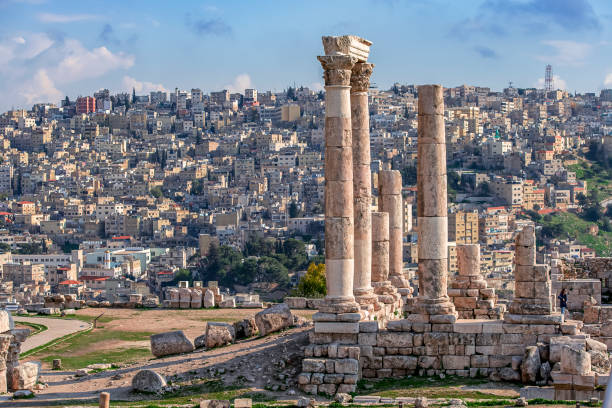 Ruins of the Temple of Hercules on the top of the mountain of the Amman citadel with a view of the ancient Middle Eastern city stock photo
