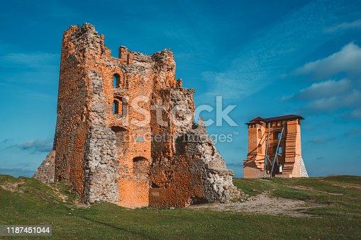 Ruins of Towers and Mindovg Castle on blue sky background in Novogrudok city, Belarus.