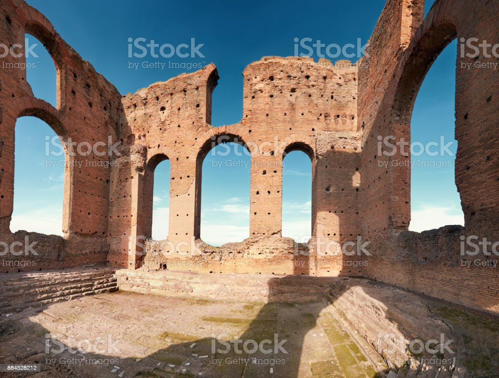 Ruins of Villa dei Quintili,a landmark upon Appia Way leading to Rome in Italy, panoramic image. - foto stock
