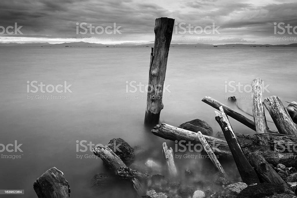 Ruins of wooden pillars at Borneo, Sabah, Malaysia stock photo