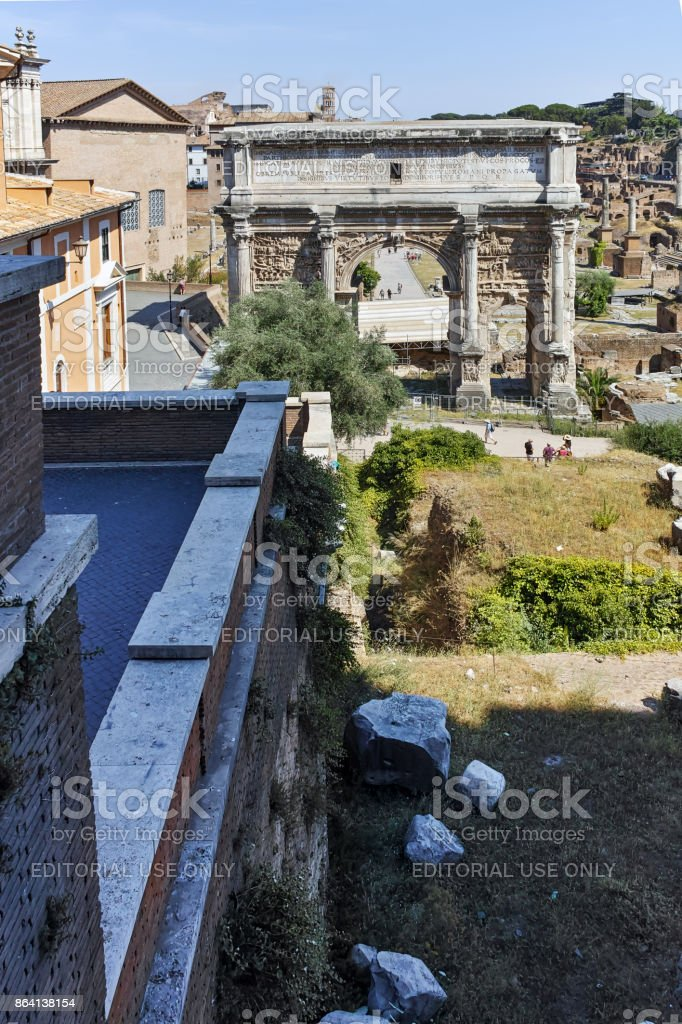 Ruins Septimius Severus Arch and Roman Forum in city of Rome, Italy royalty-free stock photo
