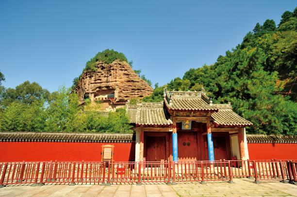 Ruiyiing Temple and Maijishan Grottoes behind it, Tianshui, Gansu province, China. stock photo