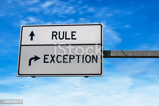 Rule versus exception. White two street signs with arrow on metal pole. Directional road. Crossroads Road Sign, Two Arrow. Blue sky background.