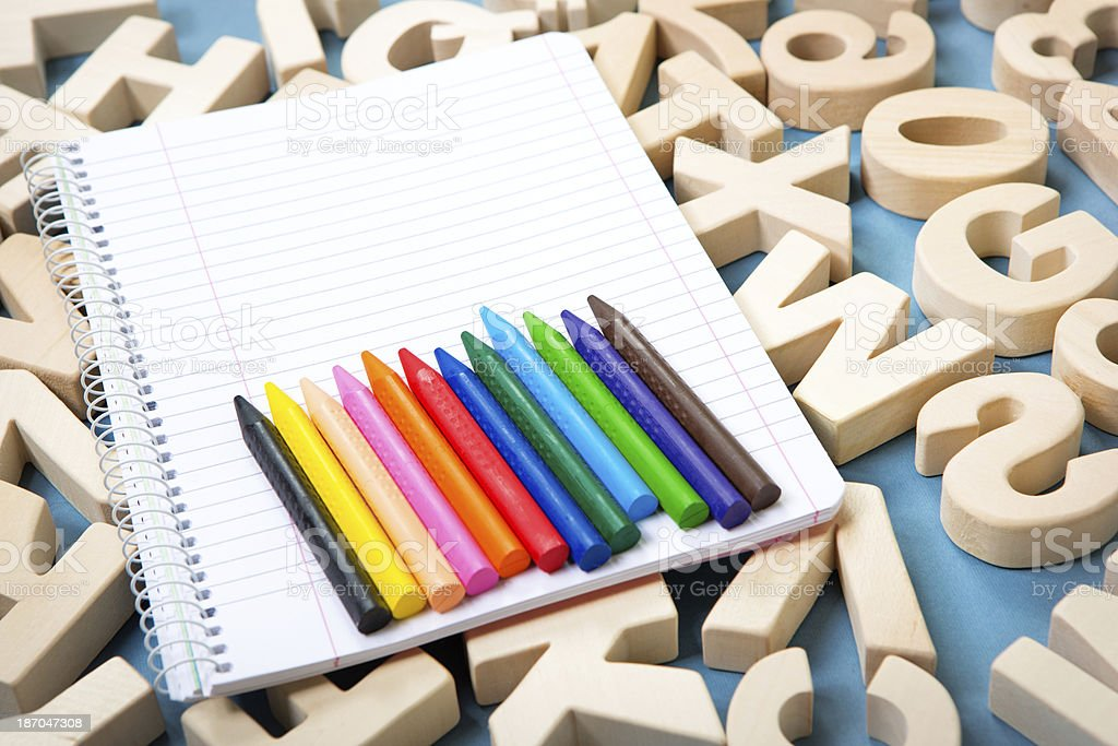 Ruled note pad with crayons royalty-free stock photo