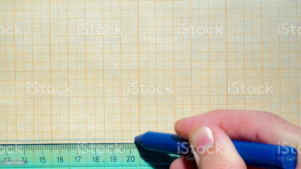 Ruler and crayon on graph paper – zdjęcie