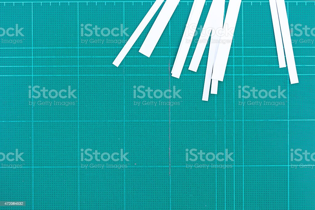 ruler and cutter on green cutting mat isolate for text stock photo