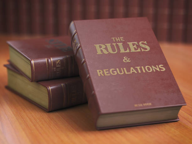 rules an regulations books with official instructions and directions of organization or team. - principio foto e immagini stock