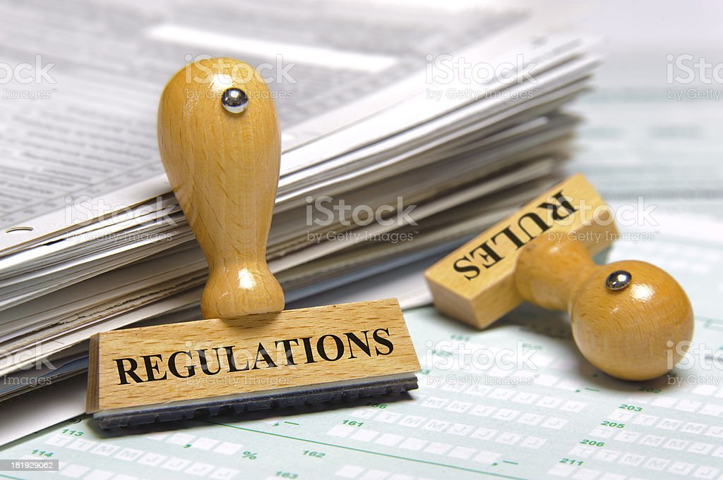 Rules and regulations on wooden rubber stamp royalty-free stock photo