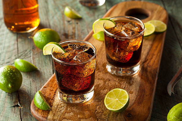 Rum and Cola Cuba Libre Rum and Cola Cuba Libre with Lime and Ice garnish stock pictures, royalty-free photos & images