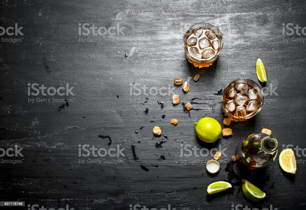 Rum with ice , mint and fresh lime. stock photo