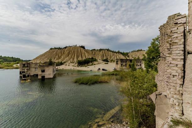 Rummu prison outbuilding in artificial lake stock photo