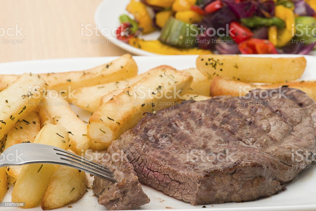 Rump steak and fries dinner royalty-free stock photo