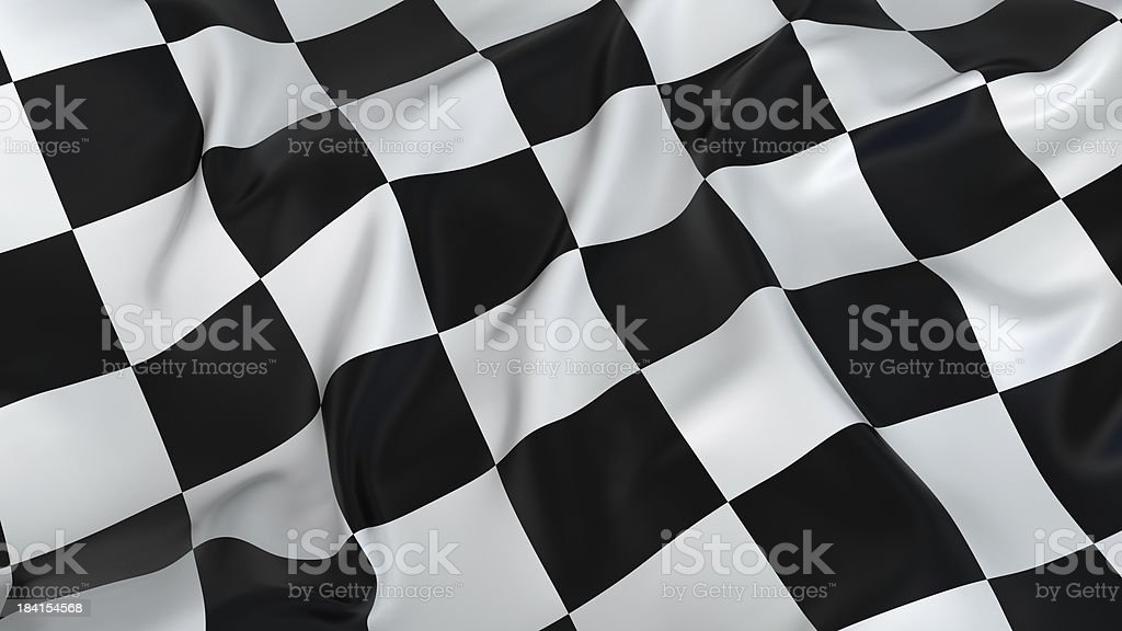 A rumpled black and white checkered flag stock photo