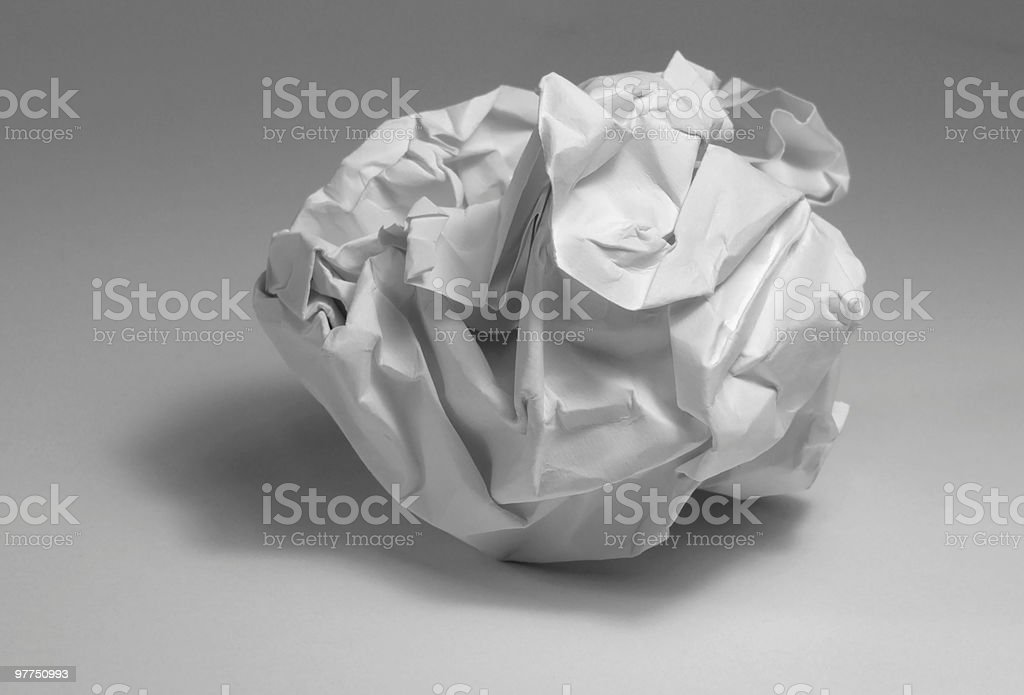 studio photography of a rumpled paper ball in grey back
