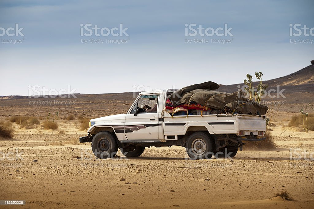 Run down 4x4 driving in Libyan desert stock photo