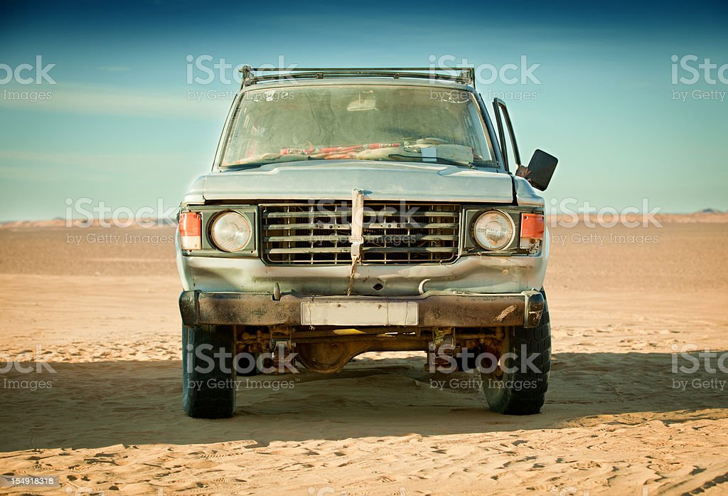 Run down 4x4 in Libyan desert stock photo