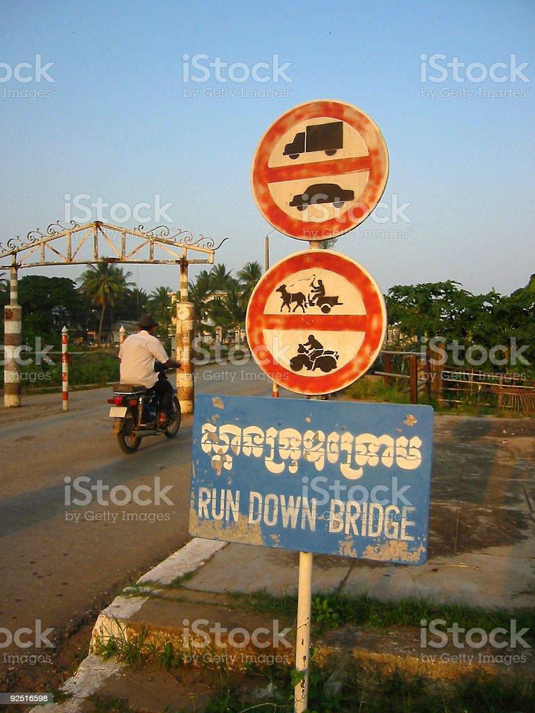 run down bridge road signs cambodia stock photo