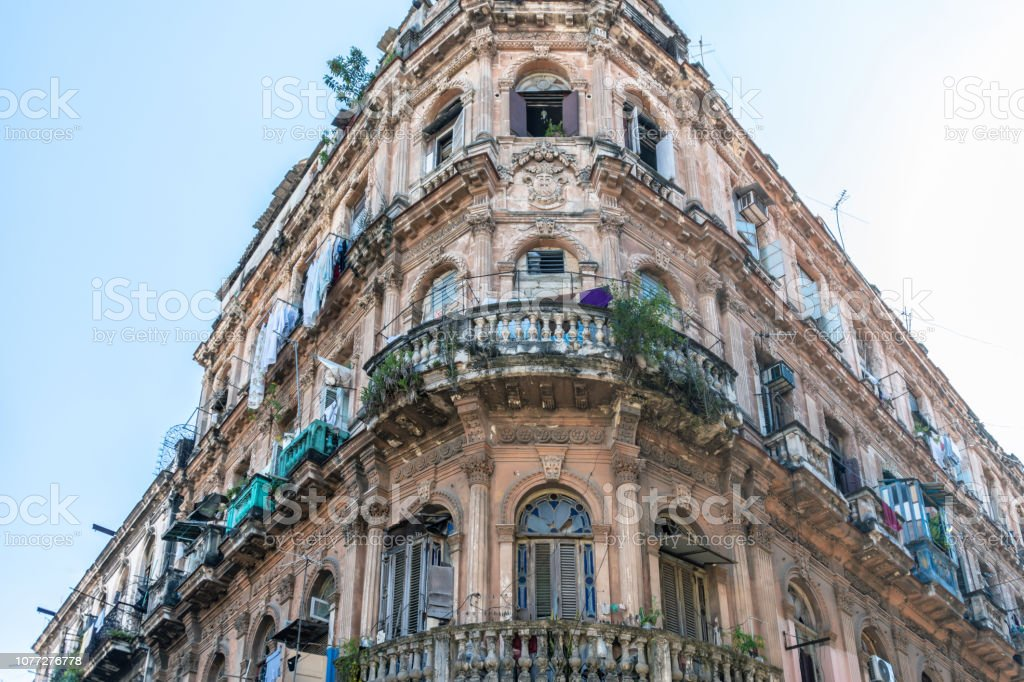 Run down old building with washing on balconies in Havana stock photo