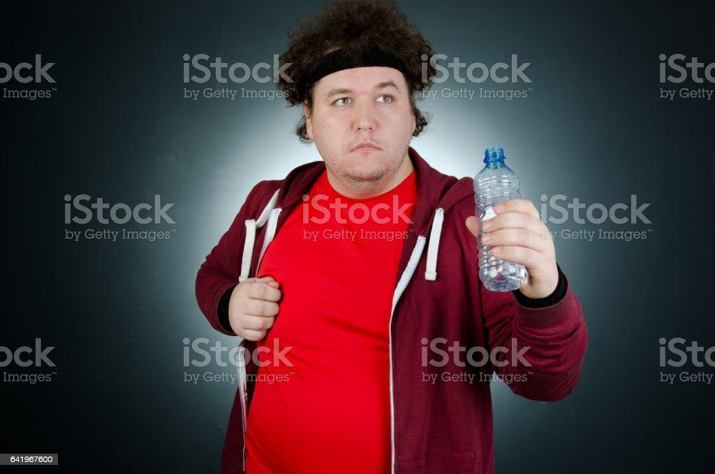 Run. Funny fat man in a hurry. stock photo