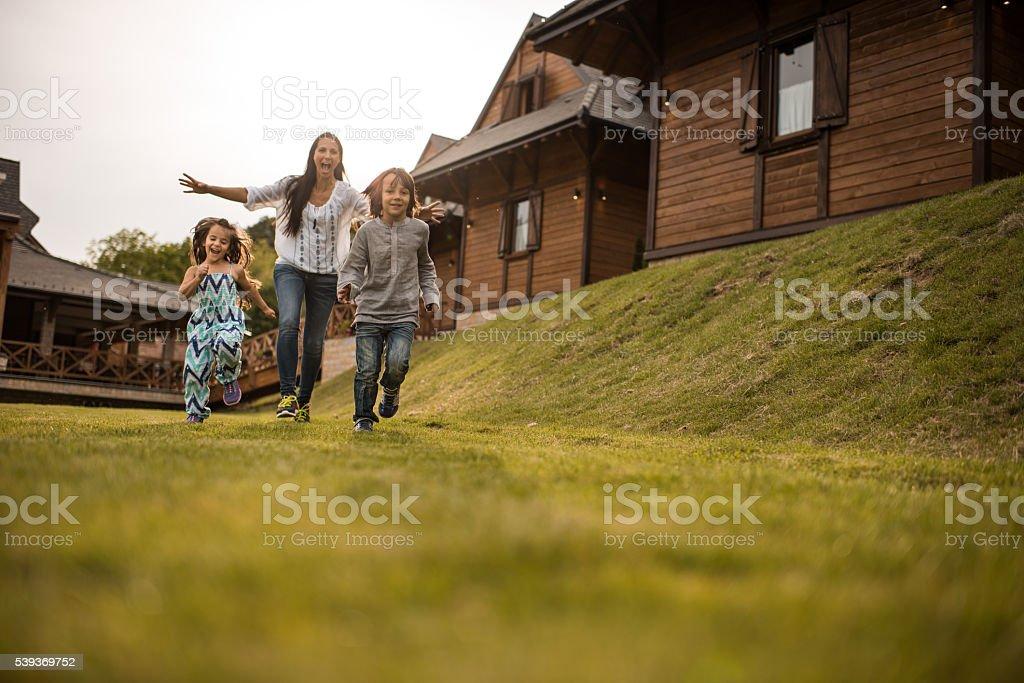 Run kids, I will catch you! stock photo