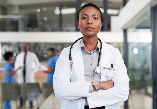 I run the show around here Portrait of a confident doctor working in a hospital female doctor stock pictures, royalty-free photos & images