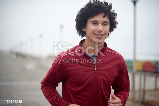 Shot of a handsome young sportsman jogging outdoors