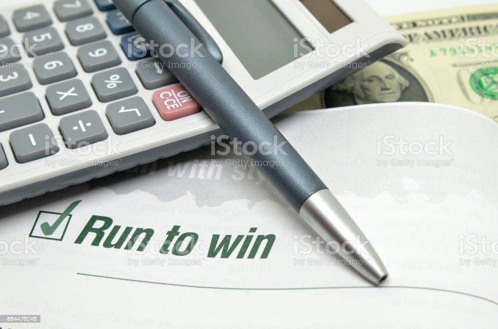 Run to win printed on book stock photo