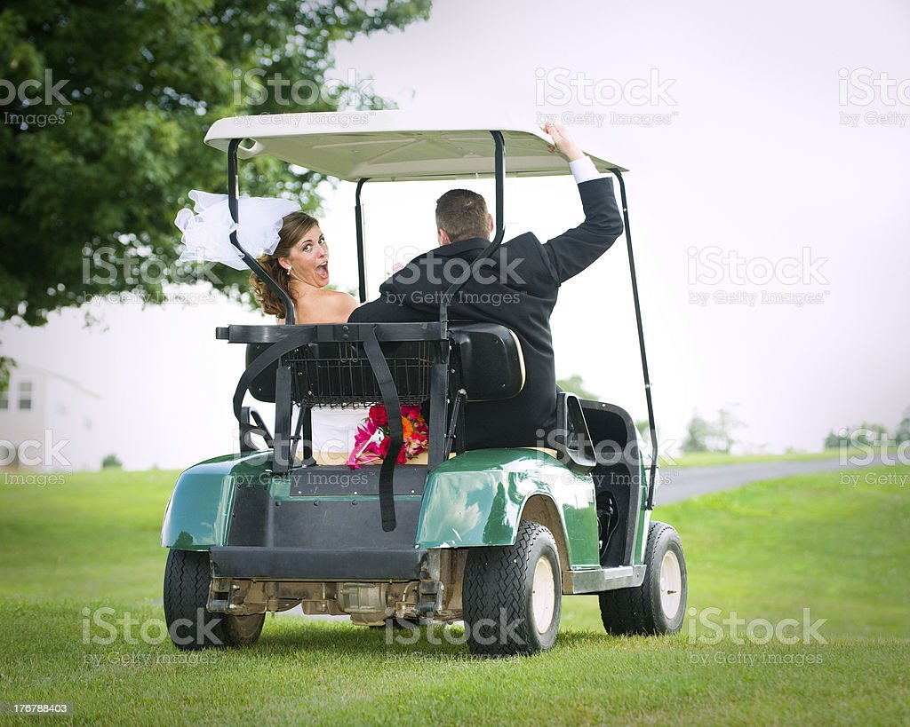 Runaway Bride and Groom in Golf Cart stock photo