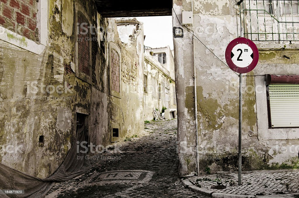Run-down alley and neighborhood in Lisbon, Portugal royalty-free stock photo