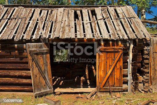 Run-Down Abandoned Log Cabin Barn in Colorado