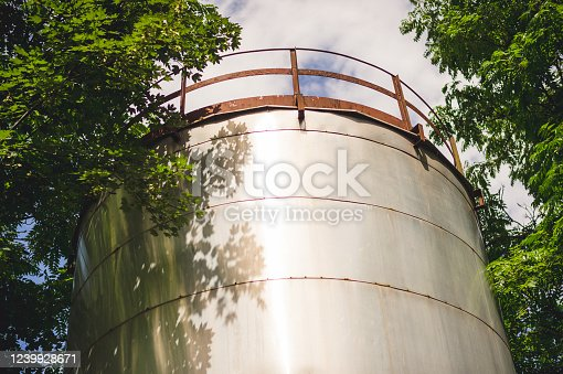 Rundown Water Tower In Park