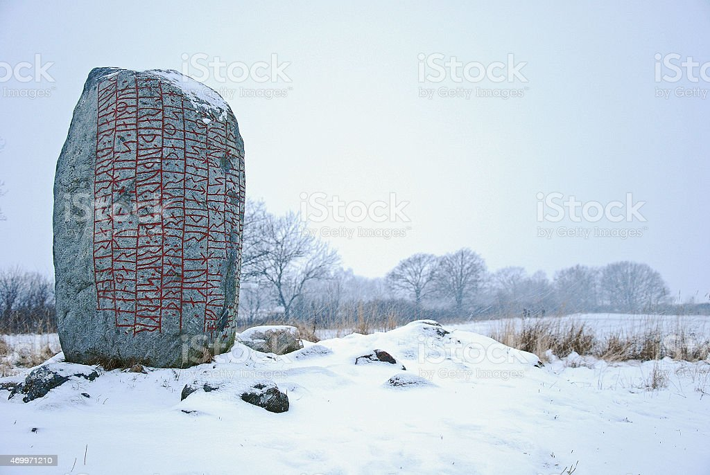 Rune stone in winter land stock photo