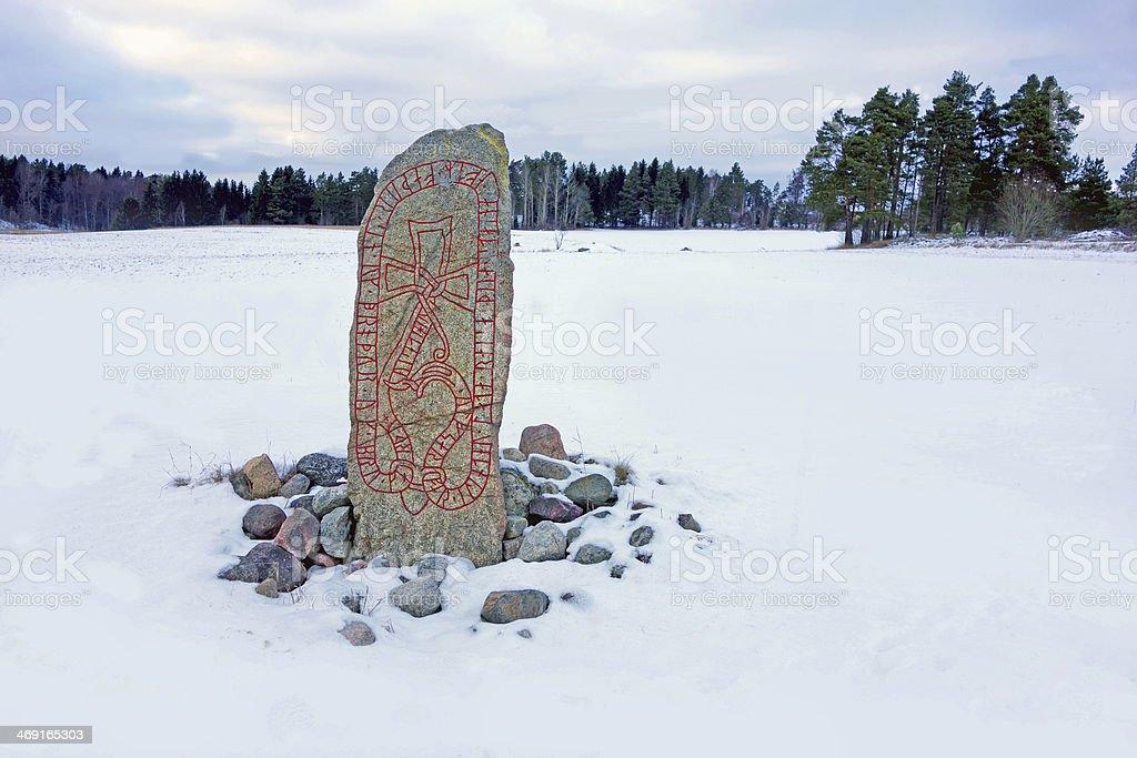 Runestone in a winter landscape stock photo