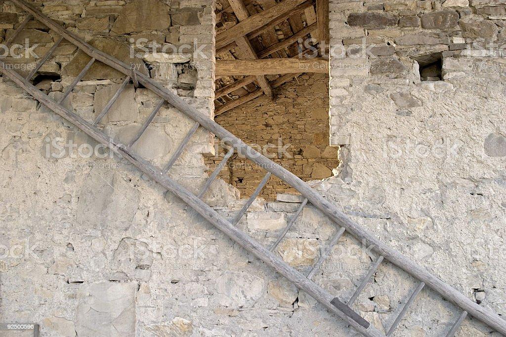 Rung ladder on a stony barn window near Perino royalty-free stock photo
