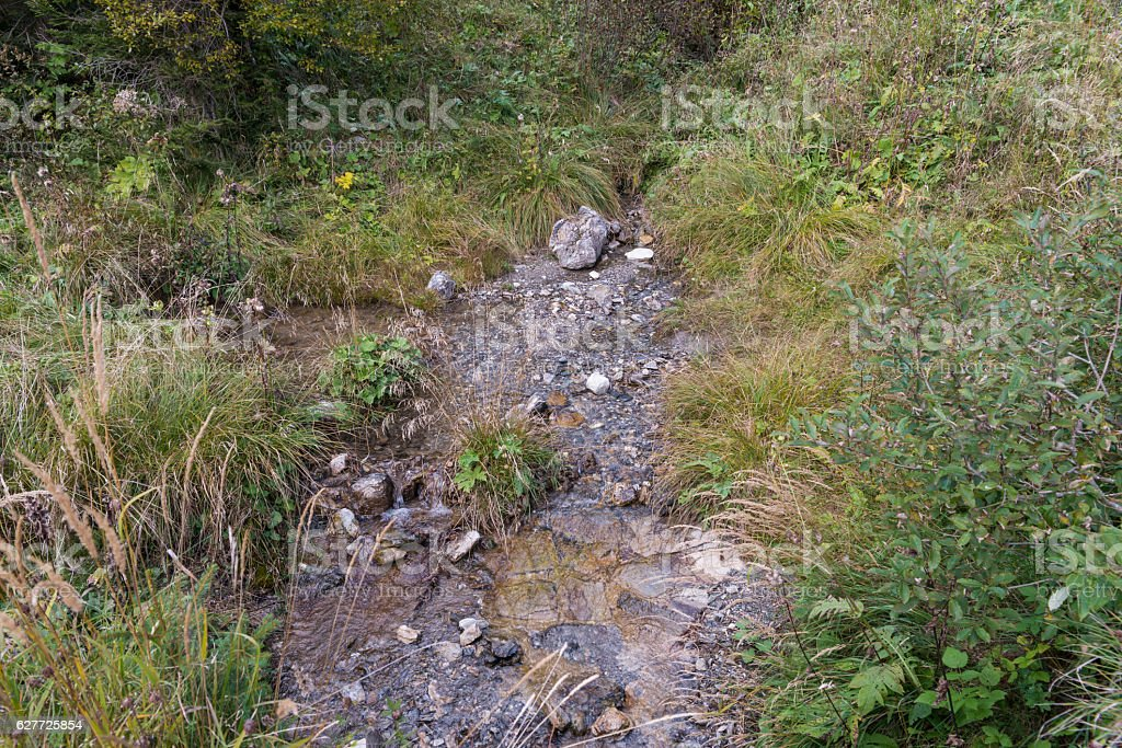 Runnel beside hiking path stock photo