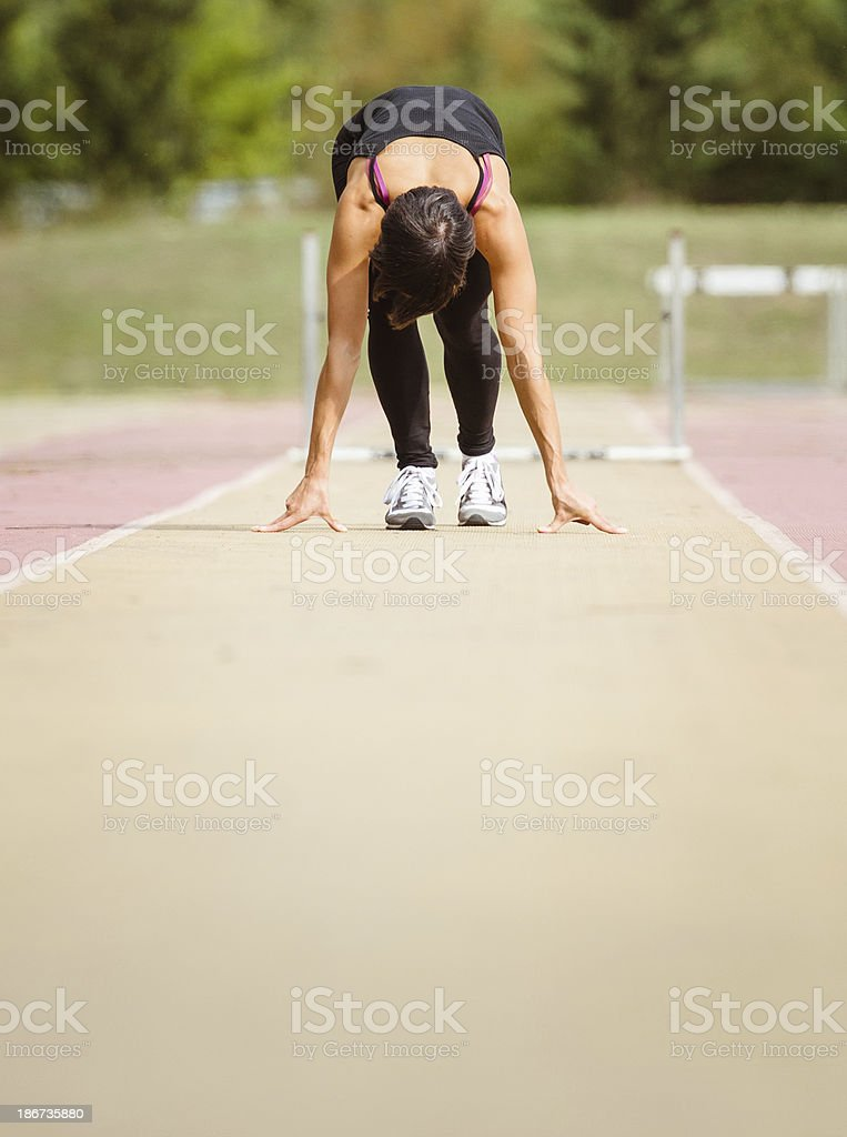 runner at starting block before the race royalty-free stock photo