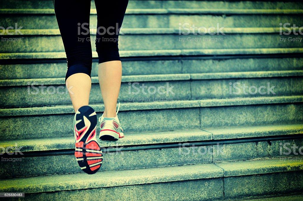 Runner athlete running on city stairs. stock photo