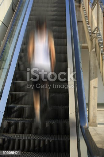 494003079istockphoto Runner athlete running on escalator stairs. 529965421